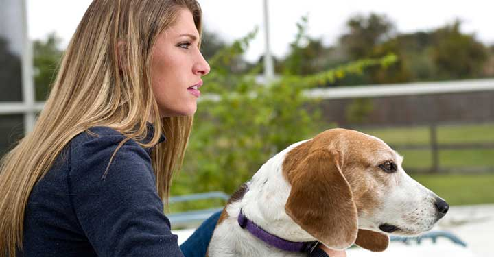 WEBwoman-and-dog-staring-off-into-distance